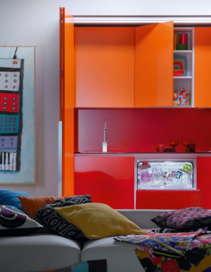 kitchen in a closet - sink and dishwasher in red and orange minimalist Logos efficiency kitchen - via Atticmag