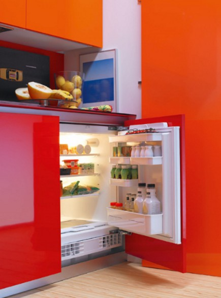 kitchen in a closet - under counter fridge in red and orange Logos efficiency kitchen - via Atticmag