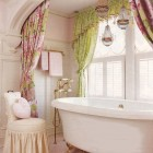 pink and green feminine bathroom with claw foot tub alcove - via Atticmag