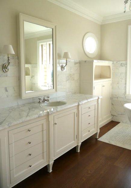 marble bathroom floors - calacatta marble bathroom with wood floor inset with marble mosaic bath mat - Velvet and Linen via Atticmag