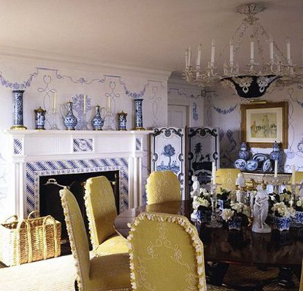 blue and white mantel garniture in a dining room by Alberto Pinto - via Atticmag