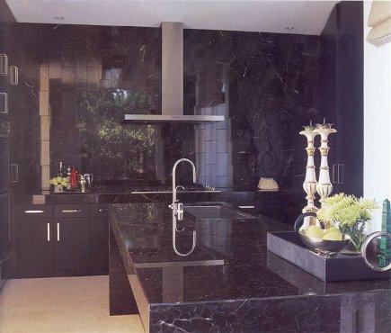 dark kitchen cabinets - black modern stone kitchen by Mark Schomisch via Atticmag