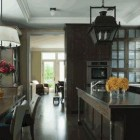 dark kitchen cabinets - dark kitchen with gray-green cabinets, floor and furniture - via Atticmag