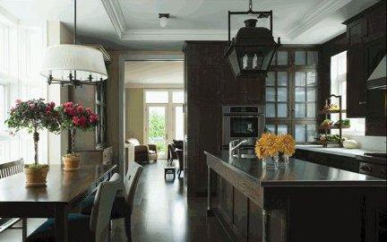 dark kitchen cabinets - dark kitchen with gray-green cabinets, floor and furniture - via Atticmag