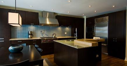 dark kitchen cabinets - dark java wood cabinets in Biglar Kinyan kitchen - via Atticmag