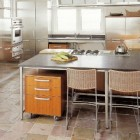industrial style Boffi Works wood veneer and stainless steel kitchen - Hamptons Cottages and Gardens via Atticmag