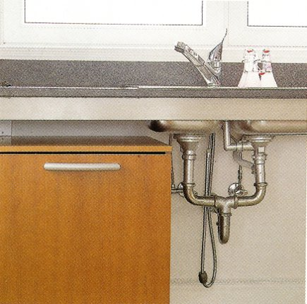 industrial style exposed plumbing in a Boffi Works kitchen - Hamptons Cottages and Gardens via Atticmag