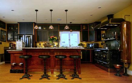 kitchen style - steampunk kitchen with black cabinets - via Atticmag