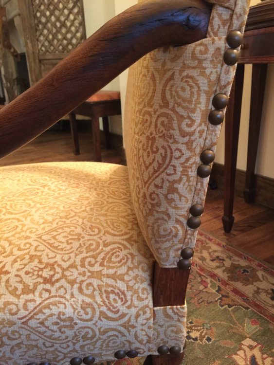 os de mouton chairs - detail image of linen fabric and nailhead trim spacing - Atticmag