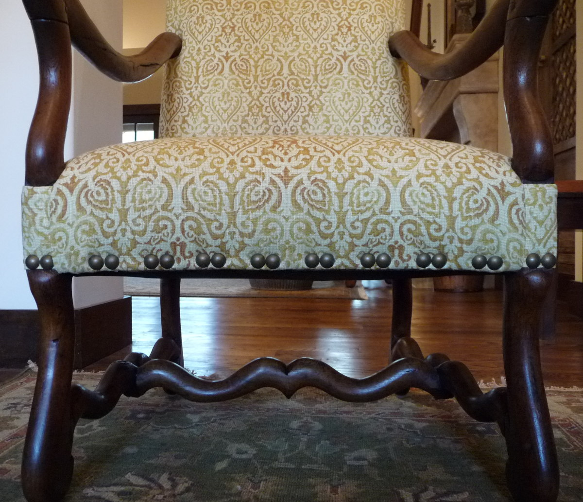 honey linen fabric and nailhead trim spacing detail on French os de mouton chairs - Atticmag