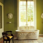 abathtubs - antique marle Roman tub in a formal bathroom in Argentina - WOI via Atticmag
