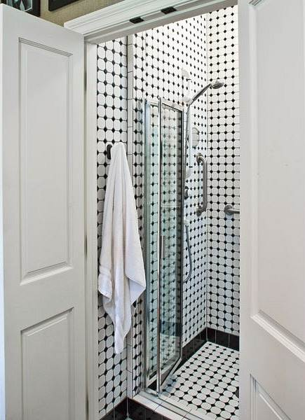 bath in disguise - black and white hexagon tile shower hidden in a closet by architect L Craig Roberts - Southern Living via Atticmag