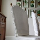 slipcover styles - linen slipcovers with side buttons - Urban Grace Interiors via Atticmag