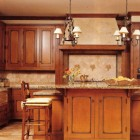 custom glazed maple cabinets with granite topped island - BH&G via Atticmag