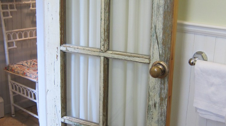 making a french door curtain for a vintage glass pane powder room door - Atticmag.com