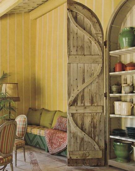 vintage wooden shutters- doors open to reveal display shelving from Architectural Digest via Atticmag