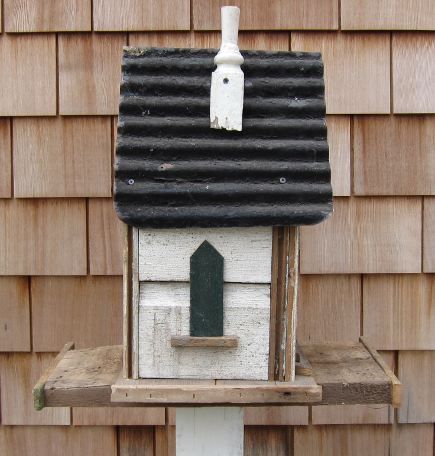 blue handmade wood and corrugated metal birdhouse - Atticmag