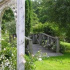 stone mansion - trellis and bridge in the Maus Park garden - via Atticmag