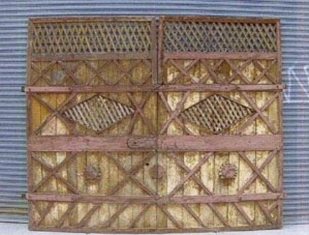 decorative interior barn doors - wooden decorative American barn doors from Treillage Ltd Bunny Williams - via Atticmag