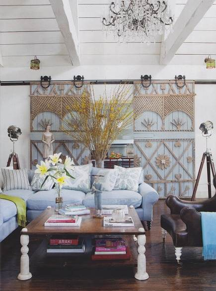 decorative interior barn doors in Ozzy and Sharon Osbourne's living room by Martyn Lawrence Bullard - Architectural Digest via Atticmag