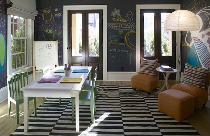 black board - children's playroom with black and white dhurrie Ikea Stokholm Rand rug and walls - via Atticmag