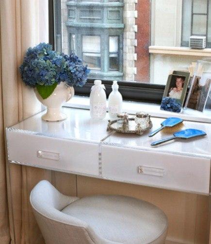 acrylic furniture - Plexi-Craft custom white acrylic bathroom vanity on wheels by Robyn Karp Interiors - via Atticmag