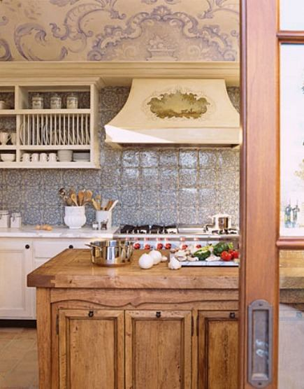 blue and white mural - tile backsplash behind range in kitchen by Erin Martin Design via Atticmag