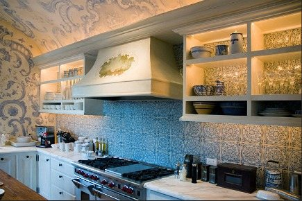 blue and white mural kitchen - blue and white tile wall behind range in kitchen by Erin Martin Design - Leong architects via atticmag
