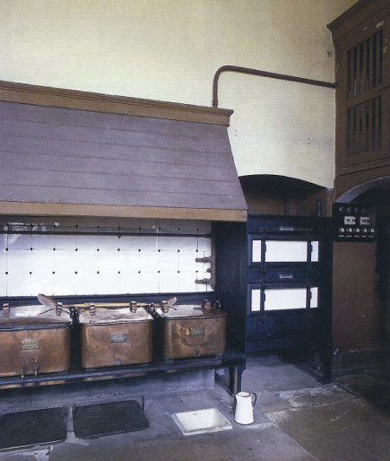 english kitchens - large copper cauldrons in the Petworth House kitchen - WOI via Atticmag