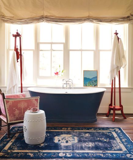 blue bathtub - blue double slipper tub and oriental rug in a red, white and blue bathroom by Mary Watkins Woods - House Beautiful via Atticmag