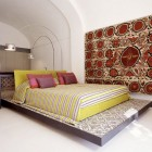 Large suzani usesd as a modern bedroom wall hanging
