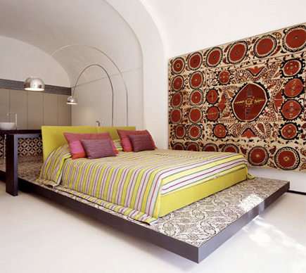 embroidered suzani - Large suzani usesd as a modern bedroom wall hanging - apartment therapy via Atticmag
