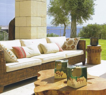 embroidered suzani - Outdoor furniture with suzani pillows - AD via Atticmag