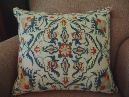 embroidered suzani - blue and orange suzani pillow cover from antiquarian textiles - Atticmag
