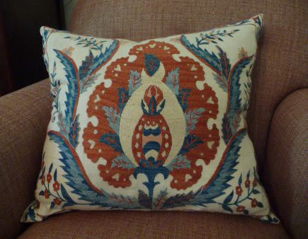 suzani textiles - orange and blue-embroidered suzani pillow covers from Antiquarian Textiles in Tashkent, Uzbekistan - Atticmag