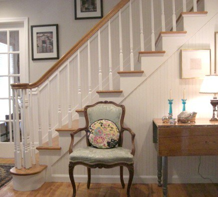 white-painted oak staircase with beadboard - Atticmag
