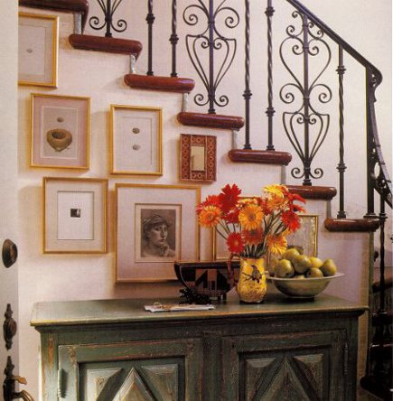 staircase with natural wood treads and wrought iron banister and balusters - via Atticmag
