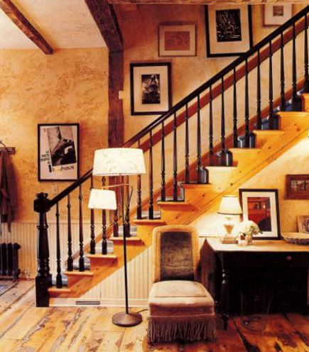 staircase with dark banister, newel post and balusters - NY Mag via Atticmag