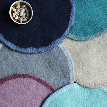 handmade felted wool round place mats from Canvas Home store via Atticmag