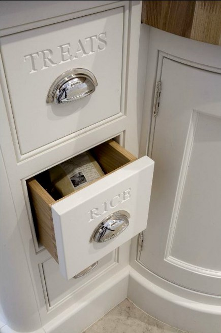 monogramming kitchens - Tom Howley cabinets with words carved onto the drawers - via Atticmag