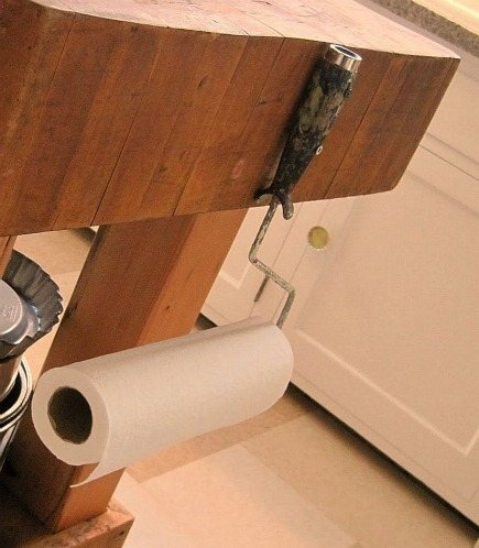 paper towel holders - repurposed paint roller handle from Junk Camp blog via Atticmag