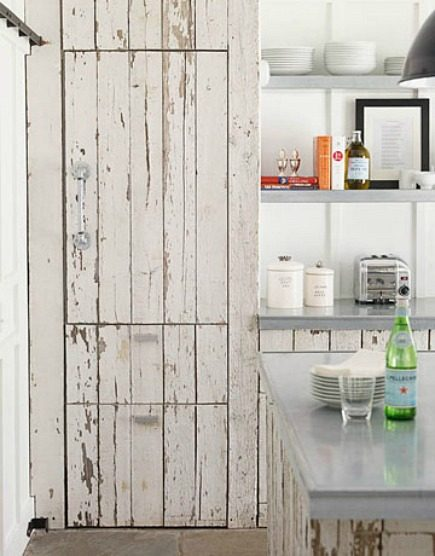 paneled refrigerator - hidden sub zero refrigerator covered with vintage wood - House Beautiful via Atticmag