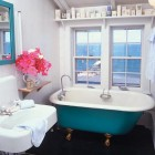 beach cottage bathroom - white and aqua cottage bath with retro fixtures and ocean view - pinterest via atticmag