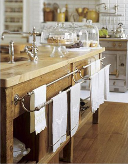antique baker's table fitted with a prep sink and vintage towel racks in a Victorian townhouse kitchen addition - House Beautiful via Atticmag