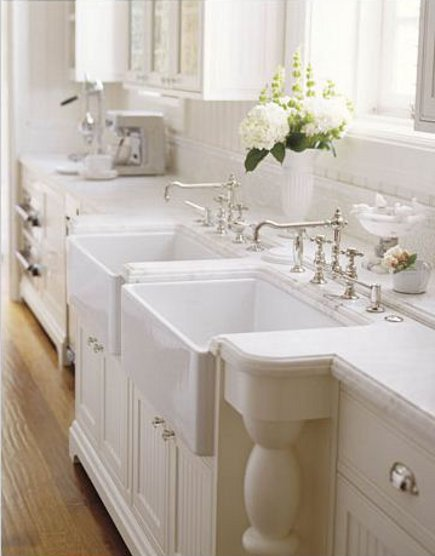 double Waterworks kitchen farm sinks with Julia faucets with Calacatta d'oro counters in a Victorian townhouse kitchen addition - House Beautiful via Atticmag