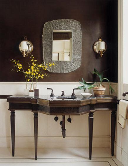 dark brown bath with anitque console and mid-century mirror by David Kleinberg
