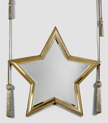 star-shaped mirror hanging from tassels