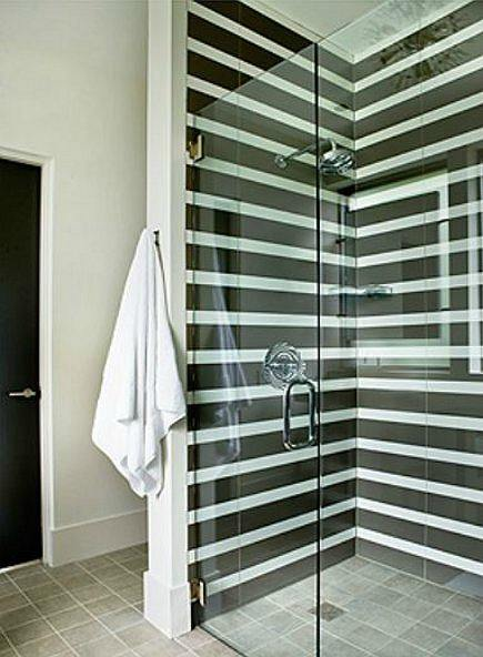 black tile showers - black and white striped shower by Amy D Morris via Atticmag