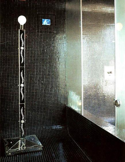 black tile showers - black glass mosaic bathroom and shower by Jeff Andrews Design via Atticmag