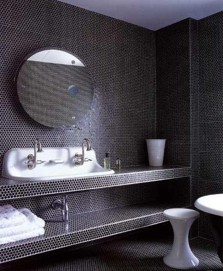 black pennyround tiled children's bathroom with lab sink